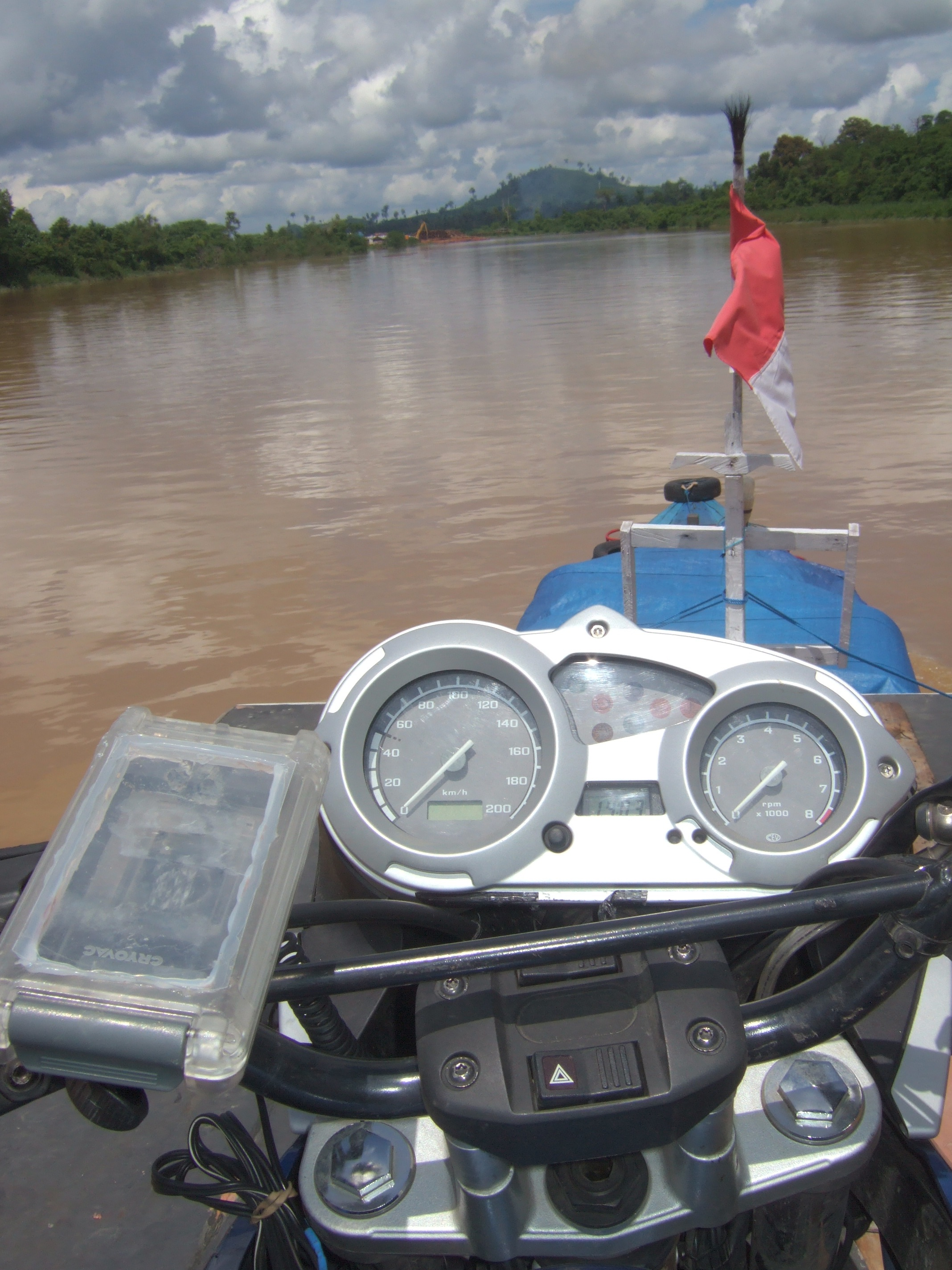 bike on the roof of a river boat in Borneo